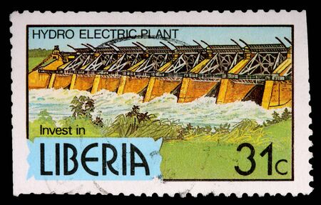 LIBERIA - CIRCA 1981: A 31-cent stamp printed in Liberia shows a hydro electric plant to encourage investment, circa 1981 Stock Photo - 9671713