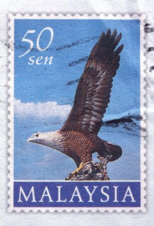 franked: MALAYSIA - CIRCA 1997: A 50-sen aerogram stamp printed in Malaysia shows an eagle preparing to take off in flight, circa 1997