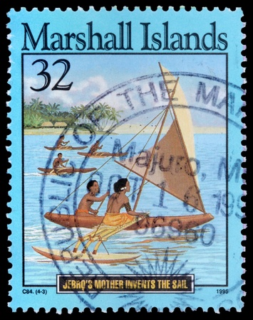 invents: REPUBLIC OF THE MARSHALL ISLANDS - CIRCA 1995: A 32-cent stamp printed in the Republic of the Marshall Islands shows islanders in canoes to illustrate the story of Jebros mother invents the sail, circa 1995 Editorial