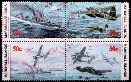 25 cents: REPUBLIC OF THE MARSHALL ISLANDS - CIRCA 1993: A panel of four, 50-cent stamps printed in the Republic of the Marshall Islands commemorates the Battle of Bismarck Sea in 1943, circa 1993