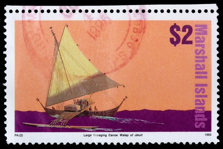 REPUBLIC OF THE MARSHALL ISLANDS - CIRCA 1993: A 2-dollar stamp printed in the Republic of the Marshall Islands shows the large voyaging canoe Walap of Jaluit, circa 1993 Editorial