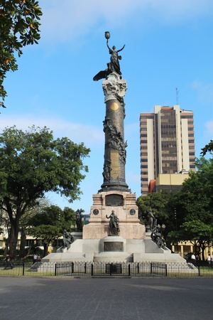 Statue of Liberty and four founding fathers of the city in the Parque Centenario (Centennial Park) on the Avenida Nueve de Octubre in the center of Guayaquil, Ecuador. Centennial Park is the largest in downtown Guayaquil and commemorates the 100-year anni