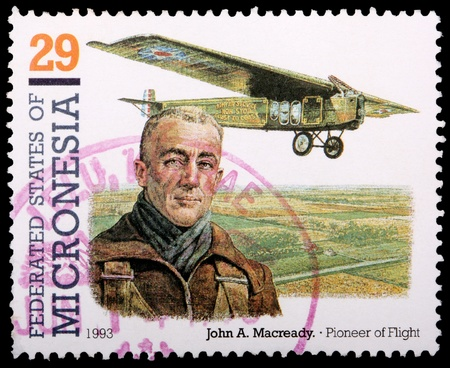 franked: FEDERATED STATES OF MICRONESIA - CIRCA 1993: A 29-cent stamp printed in the Federated States of Micronesia shows an old propeller plane and pioneer of flight John A. Macready, circa 1993 Editorial