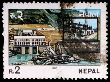 NEPAL - CIRCA 1985: A 2-rupee stamp printed in the Federal Democratic Republic of Nepal shows the Devighat hydro electric project, circa 1985
