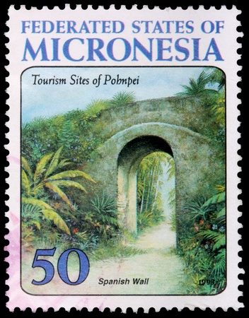 micronesia: FEDERATED STATES OF MICRONESIA - CIRCA 1998: A 50-cent stamp printed in the Federated States of Micronesia to promote tourism sites of Pohnpei shows the Spanish wall, circa 1998 Editorial