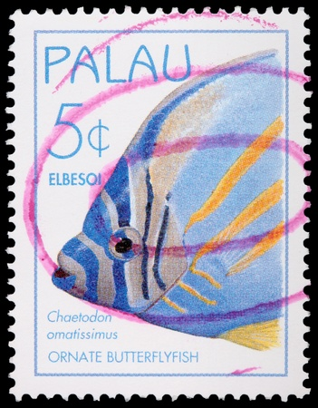 franked: PALAU - CIRCA 1995: A 5-cent stamp printed in the Republic of Palau shows the ornate butterflyfish, Chaetodon ornatissimus, circa 1995 Editorial
