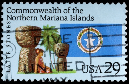 mariana: NORTHERN MARIANA ISLANDS - CIRCA 1993: A 29-cent stamp printed in the Commonwealth of the Northern Mariana Islands shows the flag and a woman leaning against some latte stones, circa 1993
