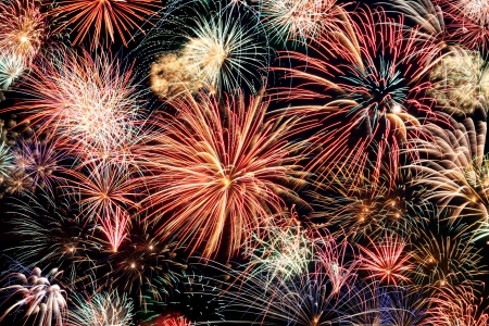 Multicolored fireworks fill the horizontal frame photo
