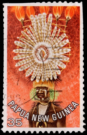 PAPUA NEW GUINEA - CIRCA 1977: A 35-toea stamp printed in the Independent State of Papua New Guinea shows a woman in a singsong costume from the area near Garaina, circa 1977