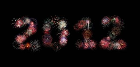 Multiple bursts of colorful fireworks were used to write out the new year 2012 photo