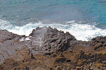 Salt spray shoots from the Halona Blowhole near Honolulu on the southeast coast of the Hawaiian island of Oahu Stock Photo
