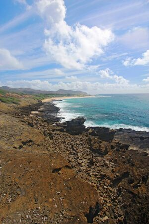 blowhole: View of Sandy Beach Park from the Halona Blowhole near Honolulu on the southeast coast of the Hawaiian island of Oahu vertical