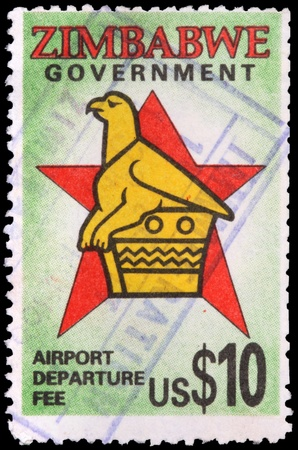 postmark: ZIMBABWE - CIRCA 1990: A 10-dollar airport departure fee stamp printed in the Republic of Zimbabwe shows a griffin and a star, circa 1990 Editorial