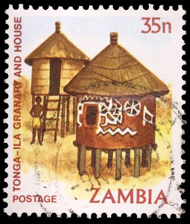ZAMBIA - CIRCA 1981: A 35-ngwee stamp printed in the Republic of Zambia shows the Tonga-Ila granary and house, circa 1981