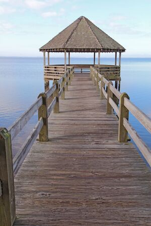 outer banks: Public gazebo and dock over Whale Head Bay off of Currituck Sound on the Outer Banks near Corolla, North Carolina vertical