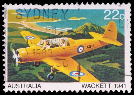 postmark: AUSTRALIA - CIRCA 1980: A 22-cent stamp printed in the Commonwealth of Australia shows the Wackett trainer aircraft in 1941 of the military training series, circa 1980 Editorial