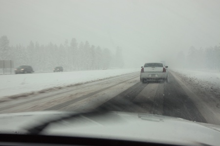 CENTRAL ARIZONA - MARCH 21: Cars in a spring snow storm on Interstate 17 south of Flagstaff, Arizona, on March 21, 2011. The highway was closed at milepost 306 for several hours due to ice and snow.
