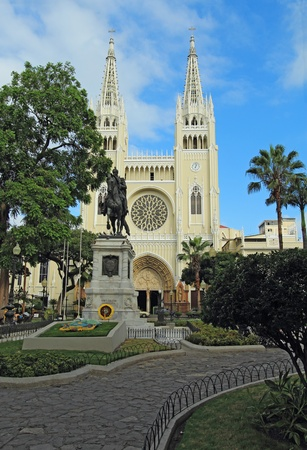guayaquil: Facade of the Metropolitan Cathedral and a statue of Simon Bolivar on a horse in the Parque Seminario  Iguana Park