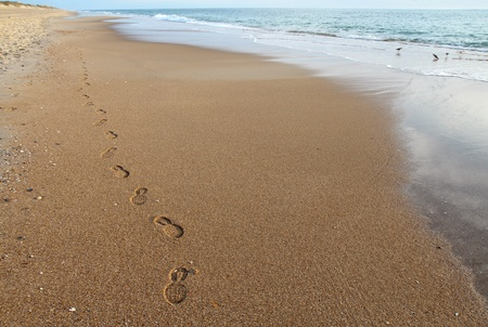 obx: A single pair of footsteps along on empty beach in the rearly morning on the Outer Banks of North Carolina Stock Photo