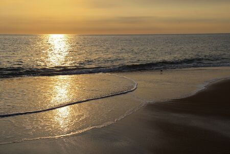 nags: Early-morning sunlight reflected off the Atlantic ocean at a beach in Nags Head on the Outer Banks of North Carolina Stock Photo