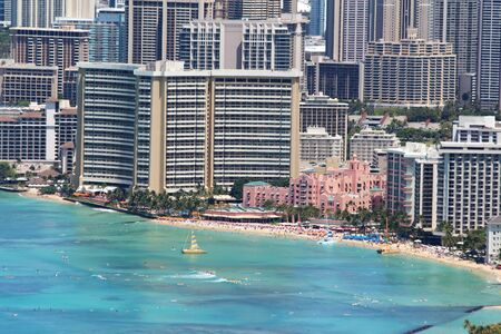 Close-up aerial view of Waikiki Beach and nearby buildings of Honolulu, Hawaii