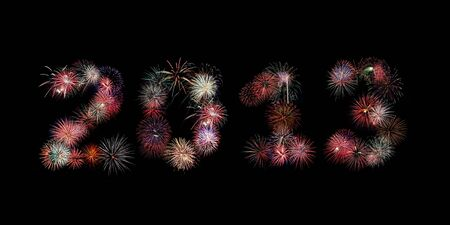 Multiple bursts of colorful fireworks were used to write out the new year 2013 against a black background photo
