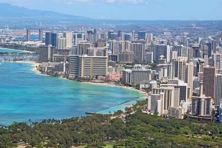 Aerial view of the skyline of Honolulu, Oahu, Hawaii, showing the downtoan and hotels around Waikiki Beach and other areas photo
