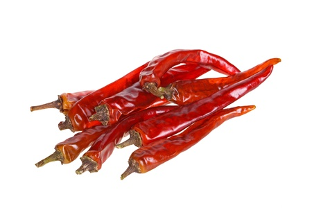 capsicums: Nine dried red hot chili peppers isolated against a white background Stock Photo