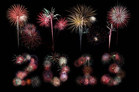 Multiple bursts of colorful fireworks were used to write out the new year 2013 with additional explosions above against a black background photo