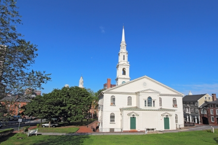 View of the First Baptist Church in America and partial skyline of Providence, Rhode Island, from College Hill against a bright blue sky