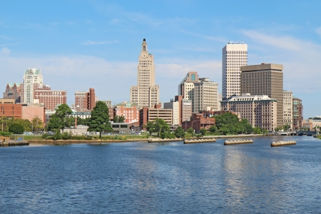ri: View of the skyline of Providence, Rhode Island, from the far side of the Providence River against a blue sky and white clouds
