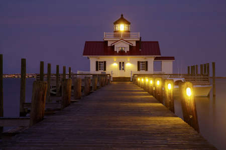 high dynamic range: Manteo, North Carolina - June 26, 2012: Replica of the Roanoke Marshes Lighthouse in Manteo, North Carolina, lit up at night