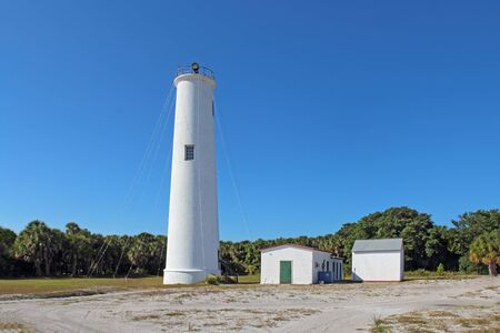 Lighthouse and associated buildings at the north end of Egmont Key, a small island near the mouth of Tampa Bay, Florida Zdjęcie Seryjne