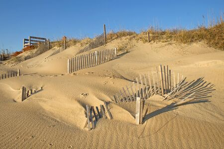 hurricane sandy: Snow fencing helps stabilize the dune line at a beach in Nags Head, North Carolina, after the ravages of recent storms including Hurricane Sandy Stock Photo