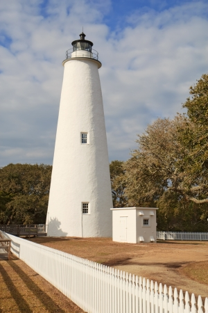 outer banks: White picket fence leads past the tower of the Ocracoke Island lighthouse on the outer banks of North Carolina, the second-oldest operating lighthouse in the United States