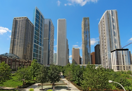 windy city: Partial skyline of skyscrapers near the Chicago River in the Loop area at the center of downtown Chicago, Illinois, against a bright blue sky  Stock Photo