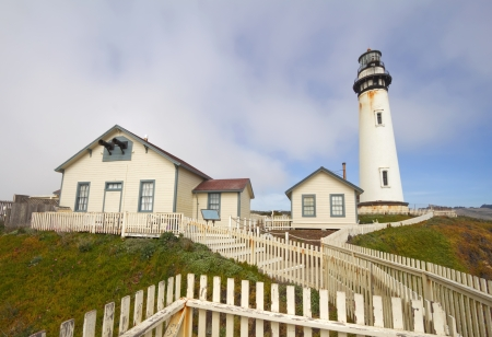 The Pigeon Point Lighthouse and white picket fence located in Pigeon Point Light Station State Historic Park between Half Moon Bay and Santa Cruz on the central California coast photo