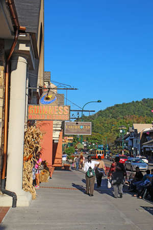 tn: GATLINBURG, TENNESSEE - OCTOBER 5: Tourists and traffic in Gatlinburg, Tennessee on October 5, 2013. Gatlinburg is a major tourist destination and gateway to the Great Smoky Mountains National Park.