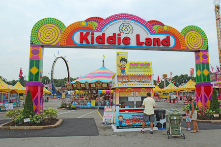 kiddie: INDIANAPOLIS, INDIANA � AUGUST 19: Entrance to Kiddie Land and rides on the Midway of the Indiana State Fair on August 19, 2011. This very popular fair hosts more than 850,000 people every August.