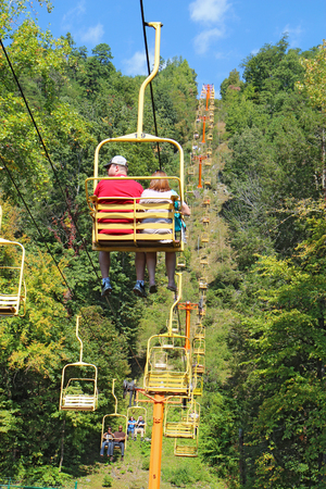 tn: GATLINBURG, TENNESSEE - OCTOBER 6: Tourists ride the Sky Lift in Gatlinburg, Tennessee, October 6, 2013. Gatlinburg is a major tourist destination and gateway to Great Smoky Mountains National Park.