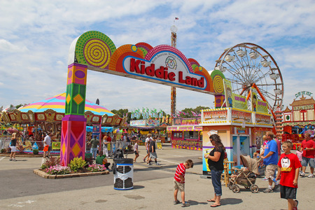 kiddie: INDIANAPOLIS, INDIANA - AUGUST 12: Entrance to Kiddie Land and rides on the Midway of the Indiana State Fair on August 12, 2012. This very popular fair hosts more than 850,000 people every August.