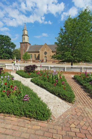 reconstructed: Gardens of Colonial Williamsburg in front of Bruton Parish Church in spring  The restored town is a major attraction for tourists and meetings of world leaders