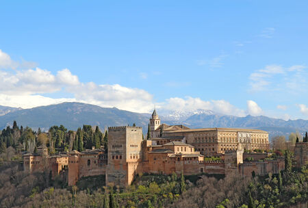 granada: Part of the Alhambra palaces and fortifications against the mountains of Granada, Spain Stock Photo