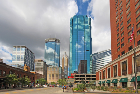 MINNEAPOLIS, MINNESOTA - AUGUST 11 2014: Skyscrapers and activity on S Marquette Ave in downtown Minneapolis, the seat of Hennepin County and the largest city in Minnesota with over 400,000 residents.