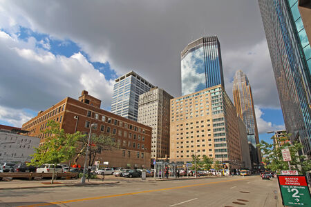 marquette: MINNEAPOLIS, MINNESOTA - AUGUST 11 2014: Skyscrapers and activity on S Marquette Ave in downtown Minneapolis, the seat of Hennepin County and the largest city in Minnesota with over 400,000 residents.