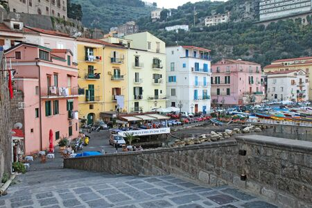 sorrento: SORRENTO, ITALY - OCTOBER 8 2014: The port of Marina Grande at dusk. This ancient gateway to the city now contains numerous restaurants for tourists and still serves as an active base for fishermen. Editorial