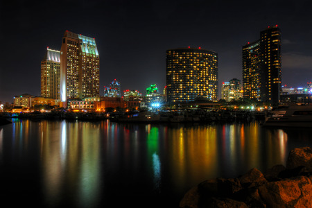 HDR image of a partial skyline of San Diego, California viewed from the water near Seaport Village and Embarcadero Marina after sunset