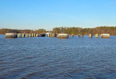 Jamestown Island docks of the Jamestown-Scotland Ferry viewed from the James River near Williamsburg, Virginia