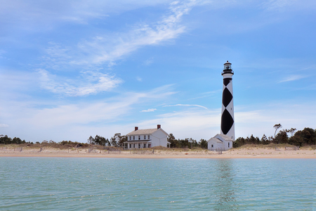 Cape Lookout Lighthouse on the Southern Outer Banks or Crystal Coast of North Carolina viewed from the water Stock Photo
