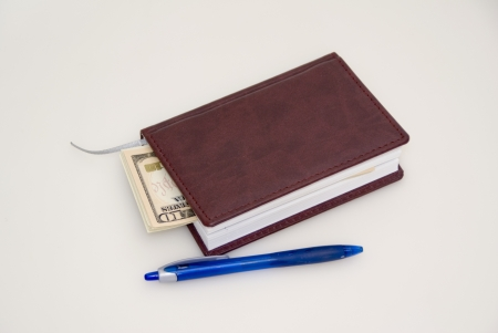 Diary, pen and money